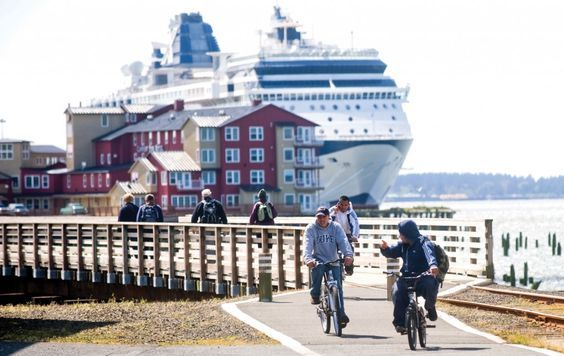 The Astoria Riverwalk offers a paved path for both walkers and bikers with views of the Columbia River and its passing ship traffic.