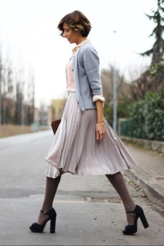 grey flowing pleated skirt grey tights black chunky heels light blue three  quarter length cardigan over white button up pink top short brown cut with  curl ...