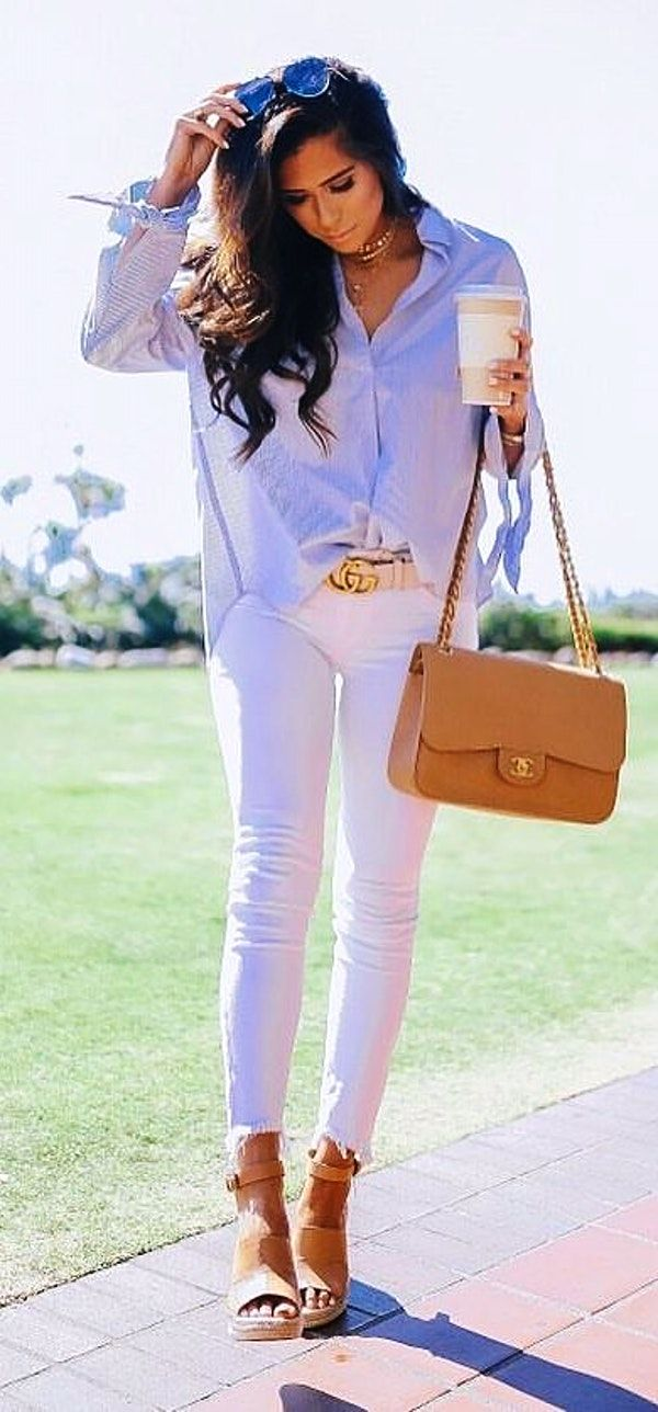 #spring #outfits  photo of woman wearing gray dress shirt holding white cup. Pic by @emilyanngemma