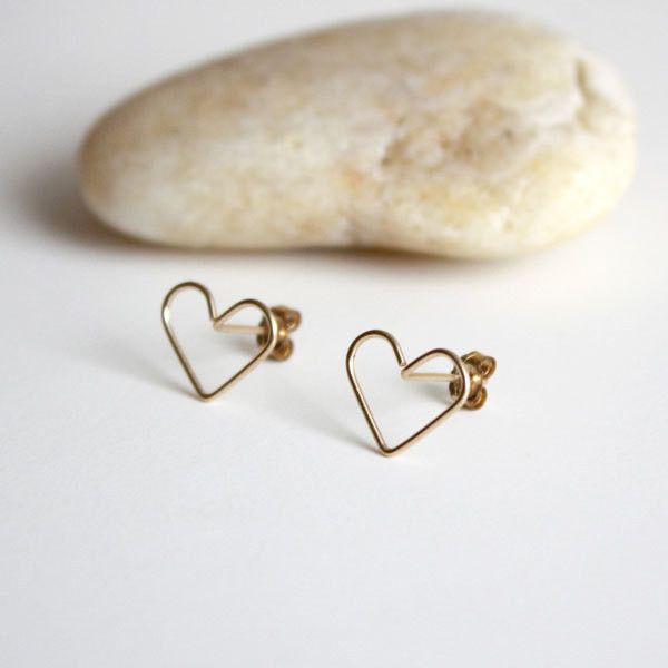 Simple, modern, and minimalist. A pair of LARGE 14k gold filled wire heart stud earrings are perfect for everyday wear! Very Lightweight. Every single piece is handmade in New York, so a shape may be