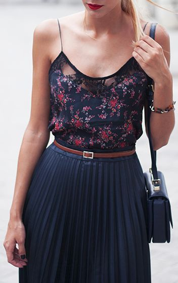 so pretty and feminine, combining a floral camisole, skinny belt, and pleated chiffon skirt.