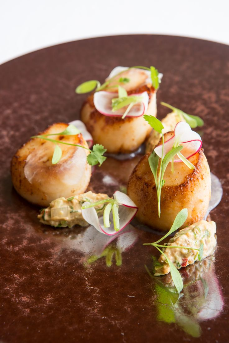 If there's one thing every home cook and dinner party enthusiast should have up their sleeve, it's an easy seafood starter recipe. With various components prepared in advance and an impressive blend of zesty flavours, Russell Bateman's fantastic scallop dish is perfect for entertaining.