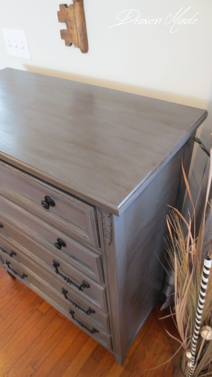 Draven Made: Bronzed Grey Dresser Two coats of GF's milk paint in Driftwood, a mid-tone grey, a layer of GF's high performance topcoat, GF's Van Dyke glaze, two more coats of topcoat.