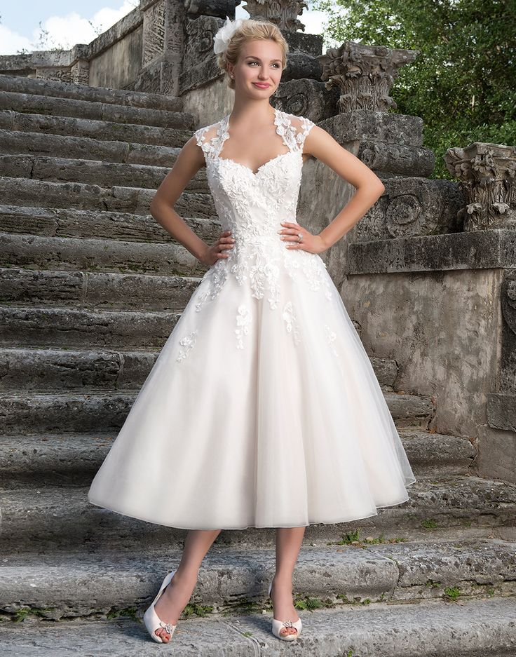 Sincerity wedding dress style 3875 This 1950's inspired tulle tea length gown features a Queen Anne neckline with beaded lace detail and a deep keyhole back.