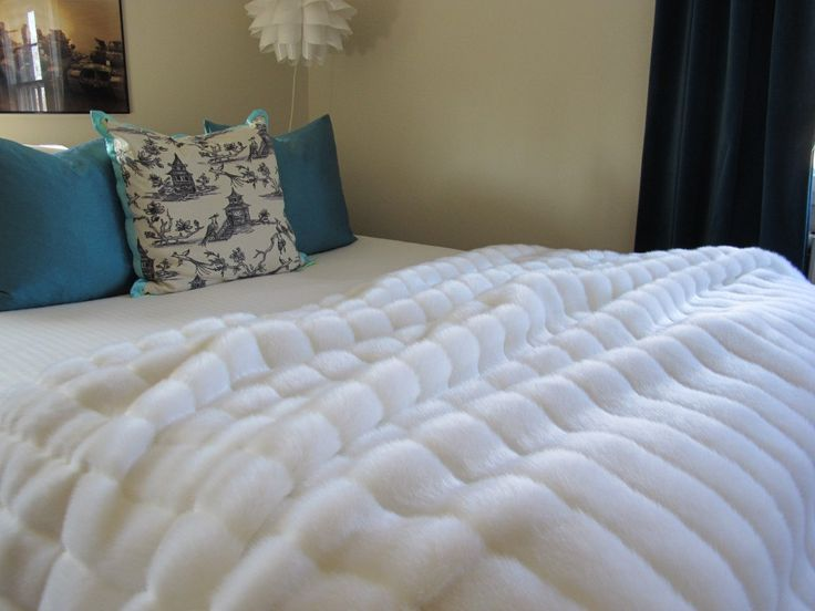 The Ultimate Luxury White Mink Faux Fur Throw Blanket. $129.00, via Etsy. she can make comforter sized