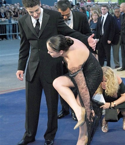 Christina Ricci gets her high heel stuck in the hem of her dress.