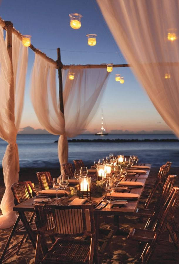 For the ultimate beach wedding, create private cabana areas, candle-lit lanterns, and tables laid out directly on the sand abutting the water.