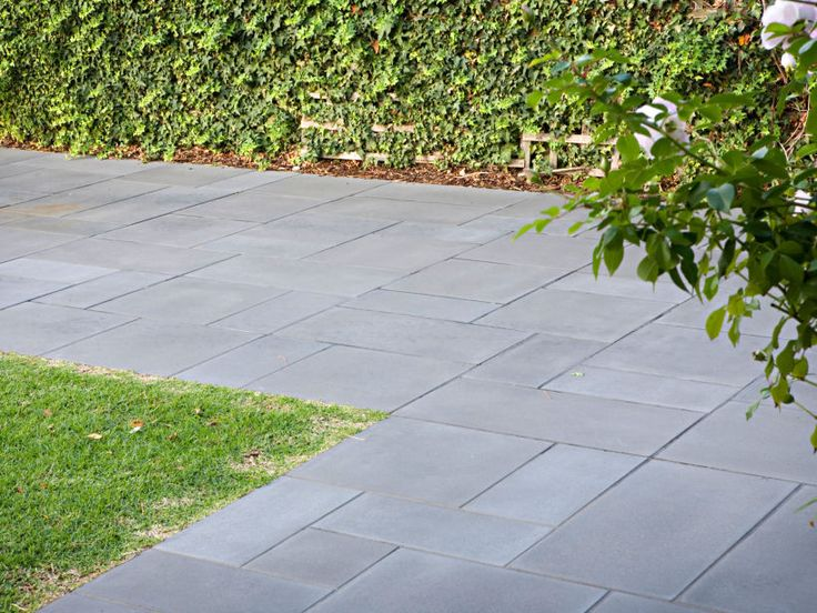 Close view of Eco Outdoor concrete pavers in modular format used as driveway. Eco Outdoor | Concrete pavers | livelifeoutdoors | Outdoor Design | Natural stone flooring | Garden design | Outdoor paving | Outdoor design inspiration | Outdoor style | Outdoor ideas | Luxury homes | Paving ideas | Garden ideas | Natural stone paving | Floor tiles | Outdoor tiles | Driveway ideas | Contemporary driveways