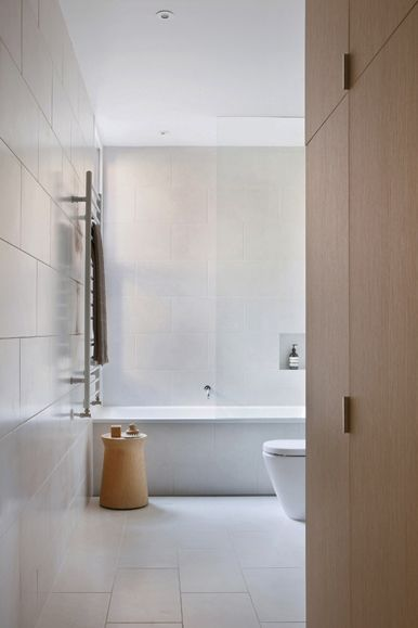 really like the simplicity of large white tiles for both floor and wall