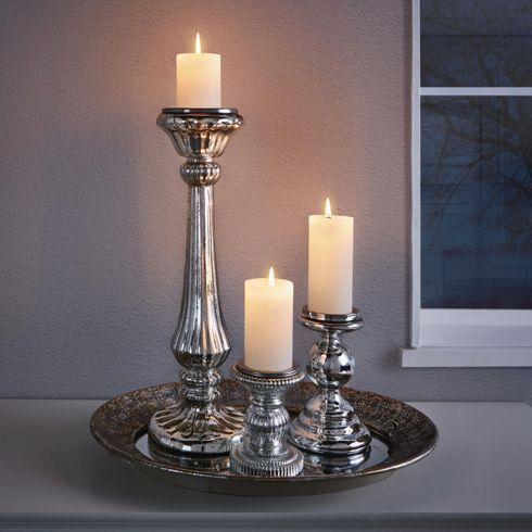Dekorativer Kerzenhalter in Silber - ein Hingucker mit Stil und Eleganz
