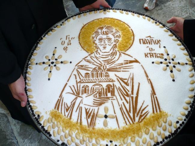 Colivă is a boiled wheat berry dessert which is used liturgically in the Eastern Orthodox Churches and Eastern Catholic Churches.  It is mixed with sugar and walnuts (often decorated with candy and icing sugar; distributed at funerals and/or memorial ceremonies)