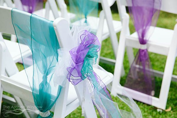blue turquoise purple peacock colours tulle for wedding chairs