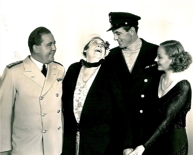 "Marie Dressler visits Charles Laughton, Gary Cooper and Tallulah Bankhead on the set of ""Devil and the Deep"", 1932"