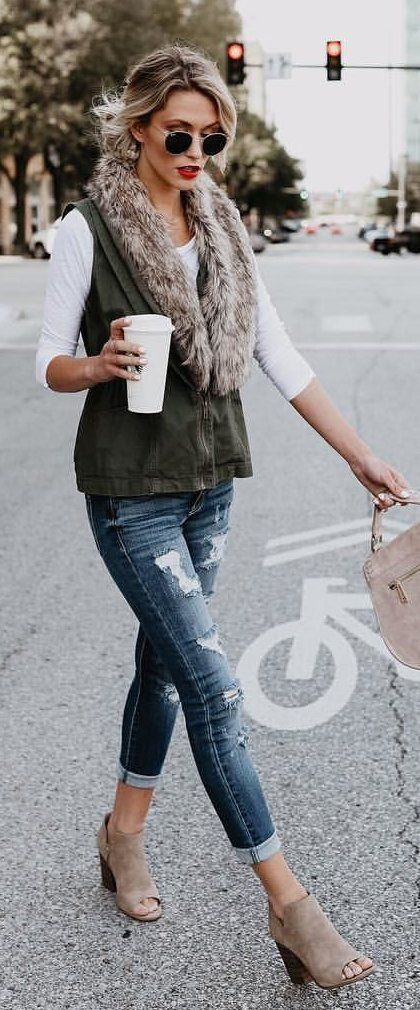 #fall #outfits women's blue jeans and brown sleeveless vest