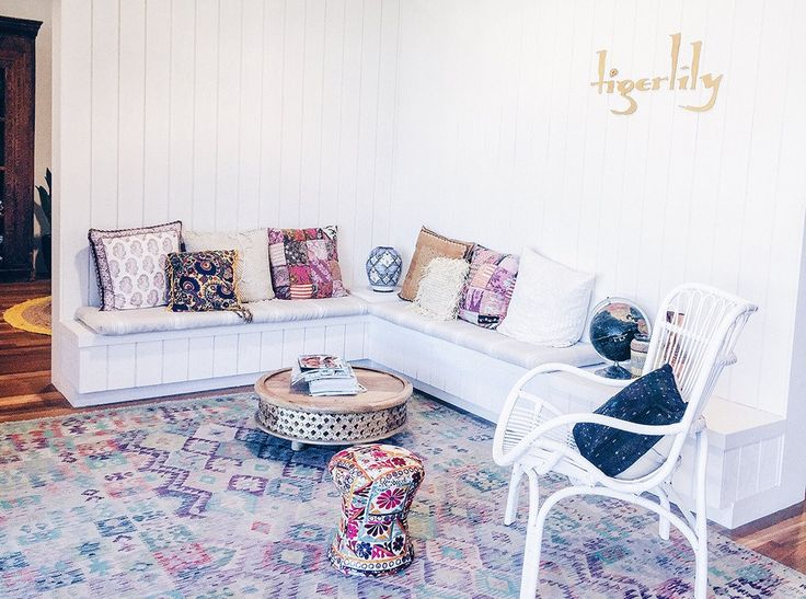 Tigerlily Swimwear design studio office inspired by bohemia lux | Beautiful boho office with white washed walls, ethnic colourful embroidered cushions and tapestries | Click to read the Design Blog