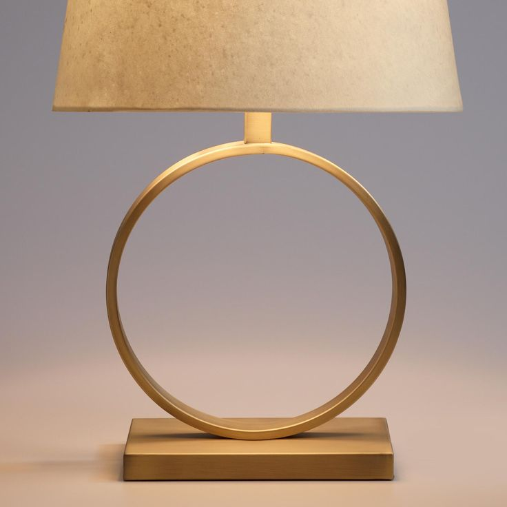 The perfect addition to your mid-century modern home, our exclusive lamp is a minimalist marvel with a circular, open design in matte brass. A gently distressed finish with visible brushstrokes adds a subtle, painterly texture and a hidden cord enhances the sculptural aesthetic.