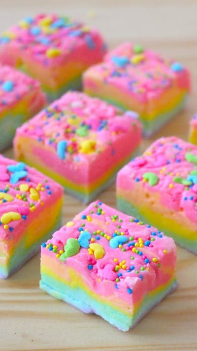 Recipe with video instructions: Who knew the rainbow tasted so chocolatey? Ingredients: 3 cups sugar, 3/4 cup unsalted butter, 2/3 cup half and half cream, 12 ounces white chocolate chips, 7 ounces marshmallow crème, Pink, orange, yellow, green, blue & purple food coloring, Rainbow sprinkles