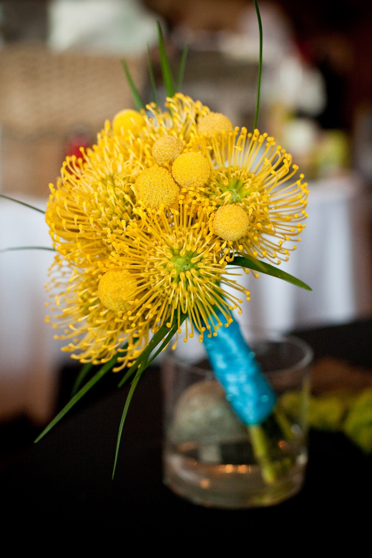 Yellow and turquoise wedding bouquet.  Pin Cushion Protea, Billy Balls, Lily Grass #yellowwedding #turquoisewedding #weddingbouquet