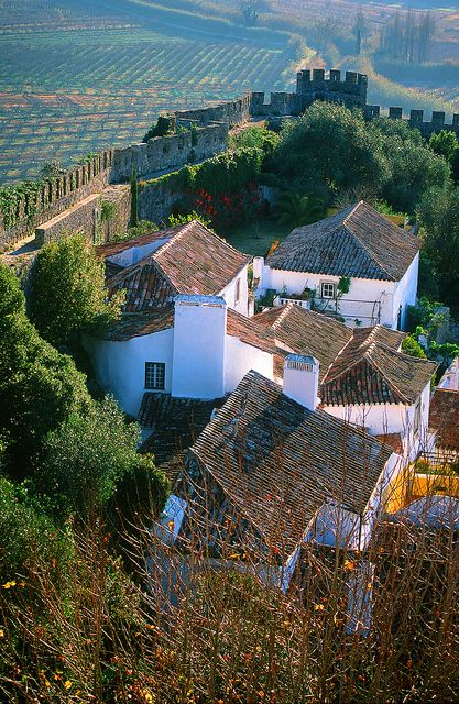 Óbidos medieval town - Portugal. North of Lisbon started as a Roman city. There are still some remains of Roman structures. After 713 the Mours took over & remained until in 1148 the 1st Portuguese king conquested it .