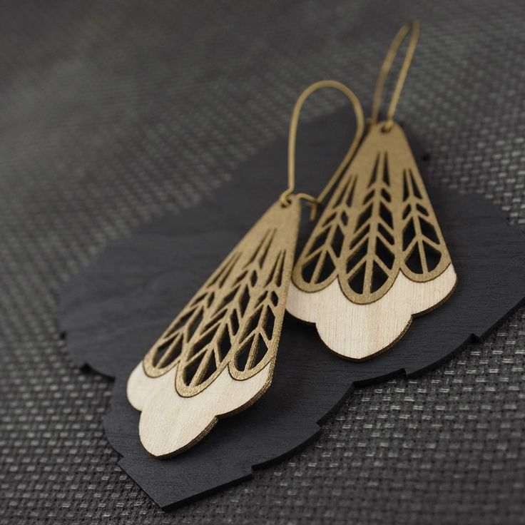 Large yet incredibly lightweight, eco-friendly Birch earrings featuring an open-cut feather design.Materials: Sustainably harvested Birch cut using green power, Raw Brass (Lead and Nickel free)...