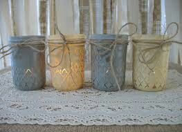 Muted grey and yellow candle holders for tables