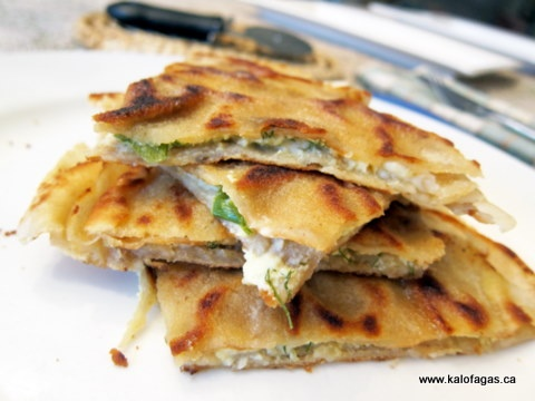 Perek or Fillota (Περέκ ή Φυλλωτά) crepe-thin pita bread comes from the cuisine of the Pontian Greeks. Stuffed with feta, scallions, and dill.