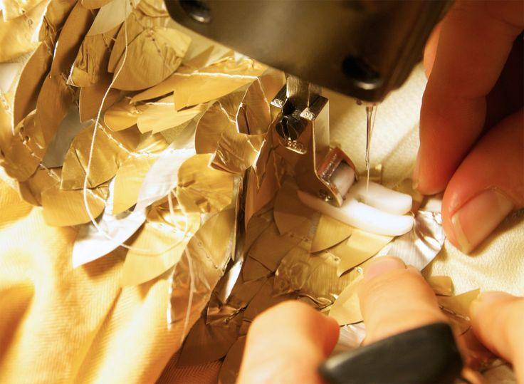 Stitching the aluminium petals- made from Nespresso capsules- onto the reclaimed shirts. www.mucke.com.au