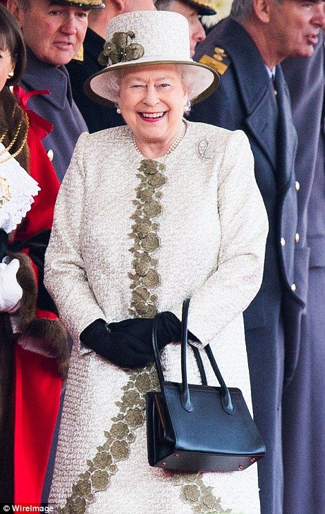 Welcome: The Queen smiles as the Mexican couple arrive...