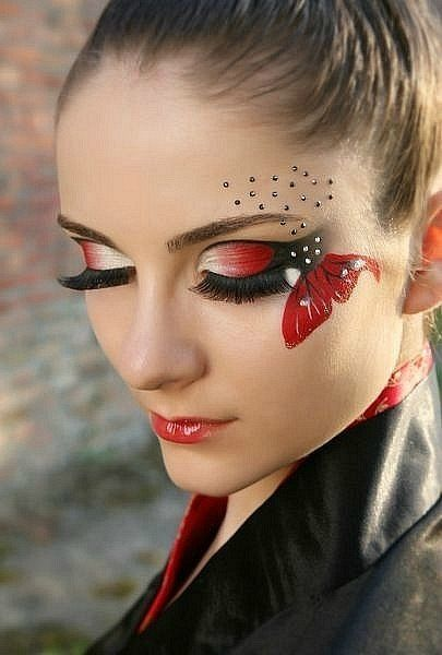 Dramatic red and black butterfly themed make-up enhanced with crystals.