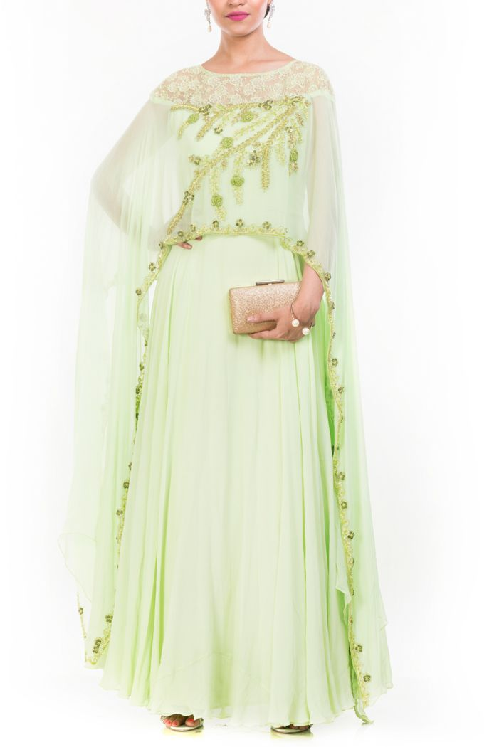 Featuring a pale green cape suit. It has a beautiful floral embroidery by using sequins and cutdana at the cape which looks like a dupatta.