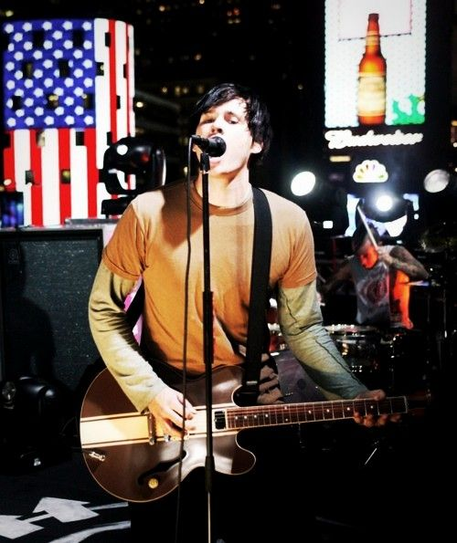 Tom Delonge. Love the t shirt with the thermal long sleeve under it look