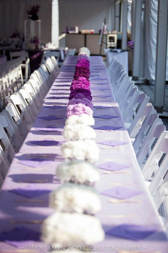 purple umbre, purple centerpieces. Wouldn't have to be at a family style table, each round could have the different shade. (ke)