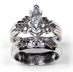 This is an absolutely stunning ring set, including a claddagh ring and a puzzle ring. I'm in love.