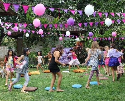 good old fashioned party games - musical chairs, sack races and balloon races!
