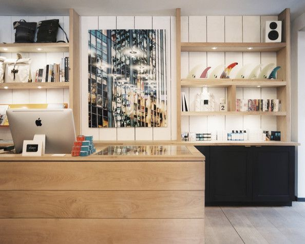 Retail Store Design Photo - Open shelving displaying bags and surfboard fins - Saturdays Surf NYC