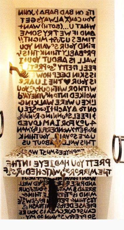 graffiti powder room, accessorized with humour
