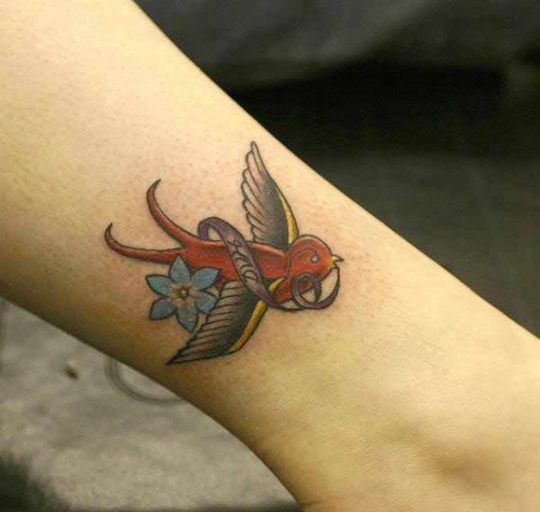 Flying red bird tattoos. Have this unique picture of flying birds tattoo and turn on yourself very attractive.