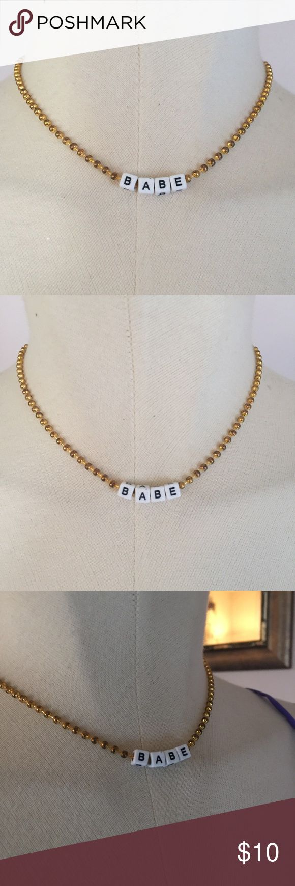 """Grunge 90's Style Gold Raver Babe Choker New Gold ball chain choker with the word """"Babe"""" on front. New and never worn. Urban Outfitters Jewelry Necklaces"""