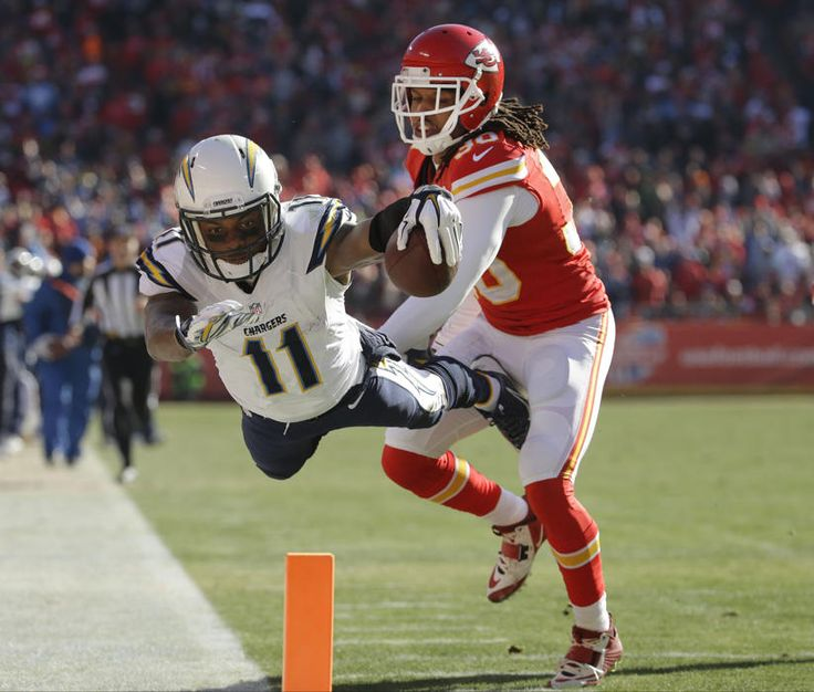 San Diego Chargers wide receiver Eddie Royal (11) is pushed out of bounds by Kansas City Chiefs defensive back Jamell Fleming (30) before reaching the end zone, during the first half of an NFL football game in Kansas City, Mo., Sunday, Dec. 28, 2014. (AP Photo/Charlie Riedel)