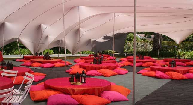 Tent decor and furniture: Moroccan-themed decor is used to create the desired, laid-back vibe.