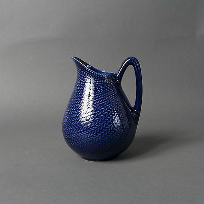 "Creamer, part of tableware range ""Blå Eld"" (""Blue Fire""), earthenware with moulded decoration, designed by Hertha Bengtson, made by Rörstrand, Sweden, 1951-1959."