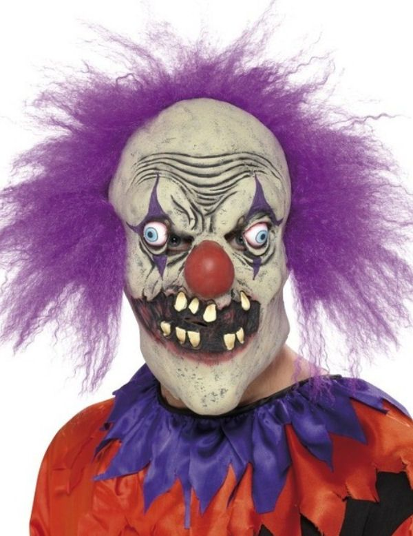 This Halloween clown half mask has purple hair sewn on the top of the head. Description from vegaoo.co.uk. I searched for this on bing.com/images