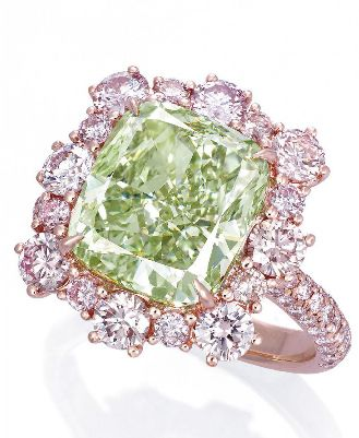 A RARE COLOURED DIAMOND RING  The cushion-shaped fancy intense green diamond weighing 6.13 carats, within a brilliant-cut pink diamond surround, extending to the half-hoop, mounted in 18k rose gold. <3