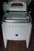 My Mom crushed her fingers in the ringer portion of a washer like this.  Dangerous