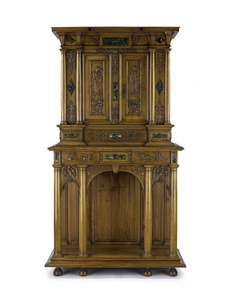 Cabinet of pearwood with arcaded lower portion, upper portion recessed in centre between pairs of flanking columns, with cupboard underneath, and cupboard door panels each carved with the figure of a woman: French, 19th century.