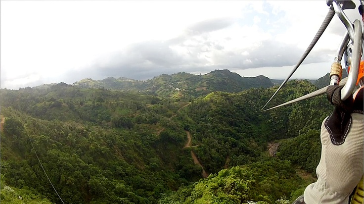 Me zip-lining mountain to mountain in PR.