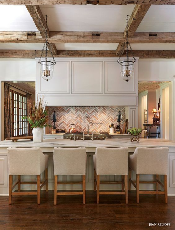 Today we hope to inspire you with examples of beamed ceiling kitchens for your own homes, and share with you about some of the pluses and minuses of the engineered wood beams now available on the market versus the authentic, antique reclaimed wooden beams.
