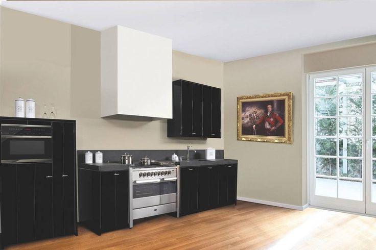 Een landelijke keuken met stijl. Het zwart-witte contrast zorgt voor een ultieme luxe uitstraling.