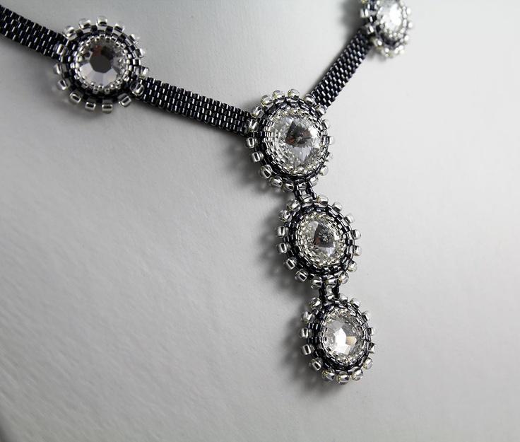 Crystal beads beaded around with TOHO Seed beads