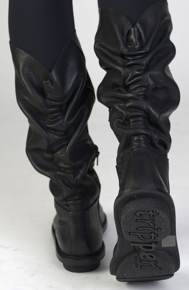 Just when I though I couldn't possibly want yet another pair of black boots...  Trippen